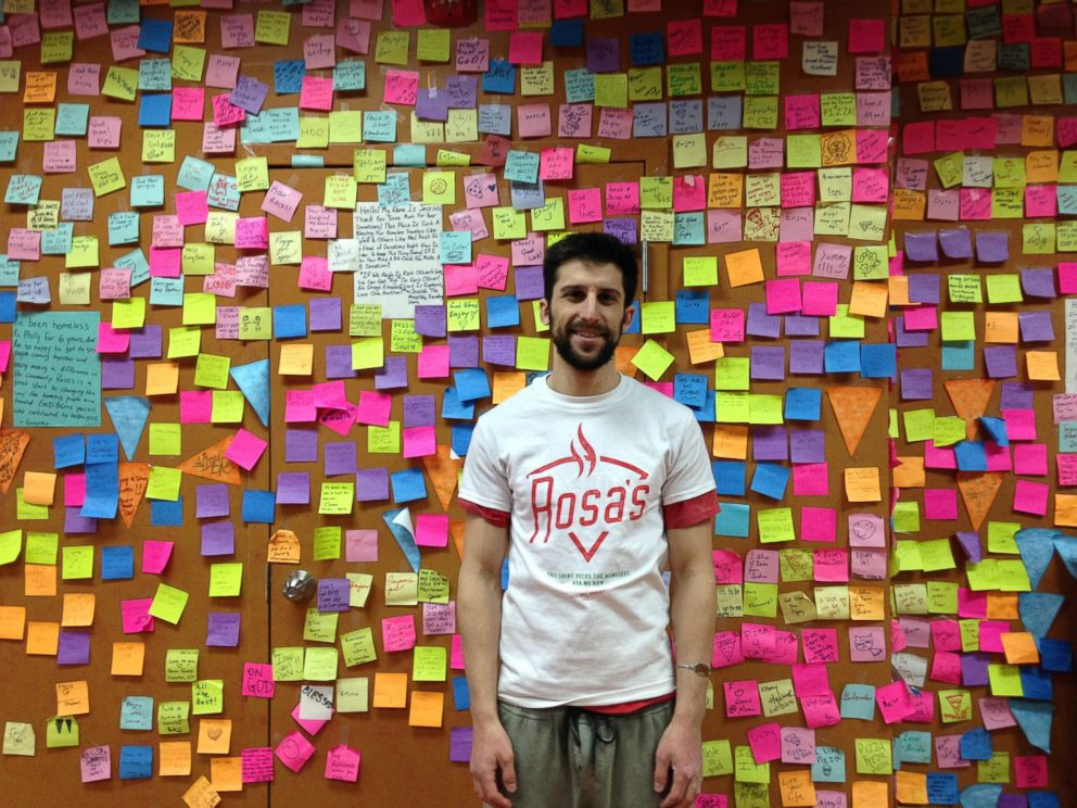 4 - Mason places a pay it forward 039post-it039 on the wall