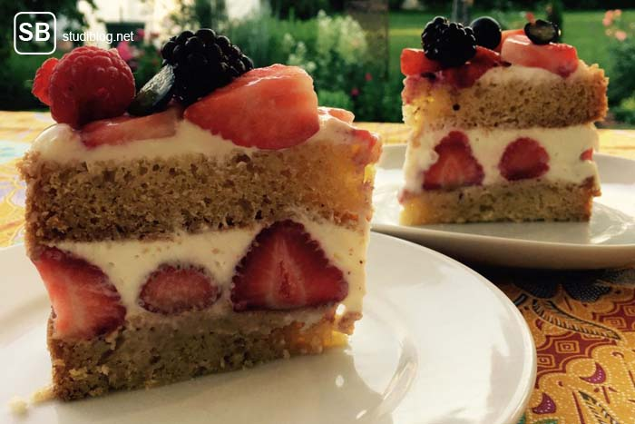 Two slices of a Victoria Sponge Cake with berries - Recipe for coming summertime.