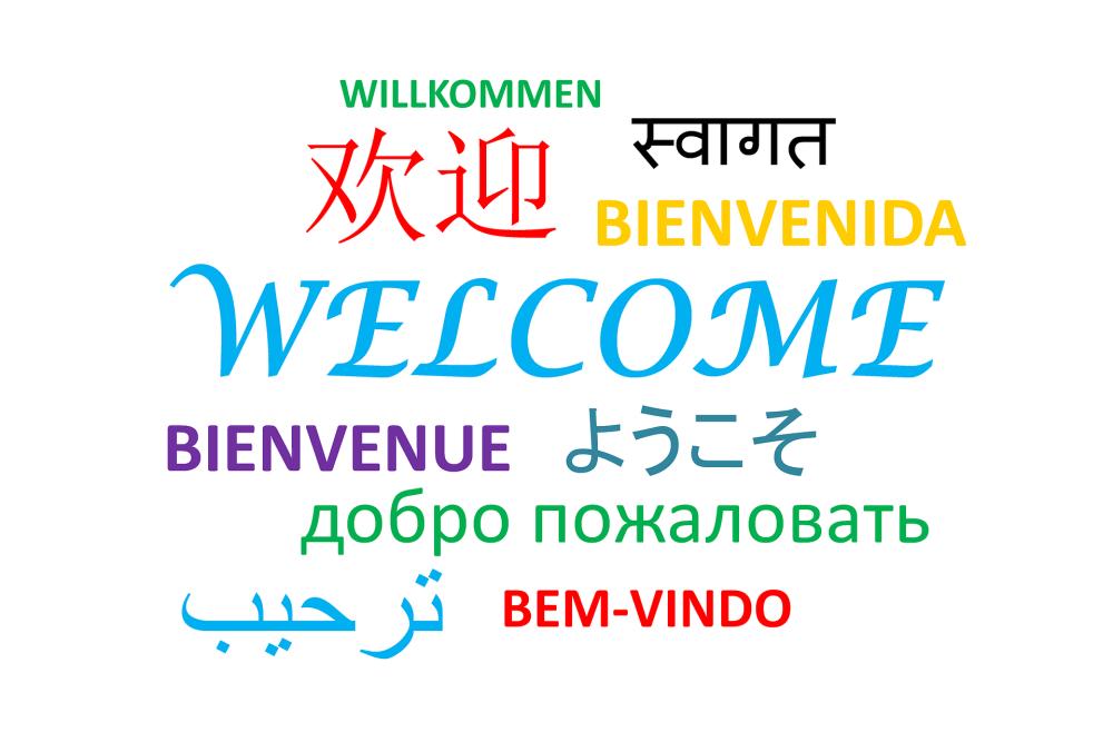 """In verschiedenen Sprachen steht das Wort """"Willkommen"""" - Sprachreise"""